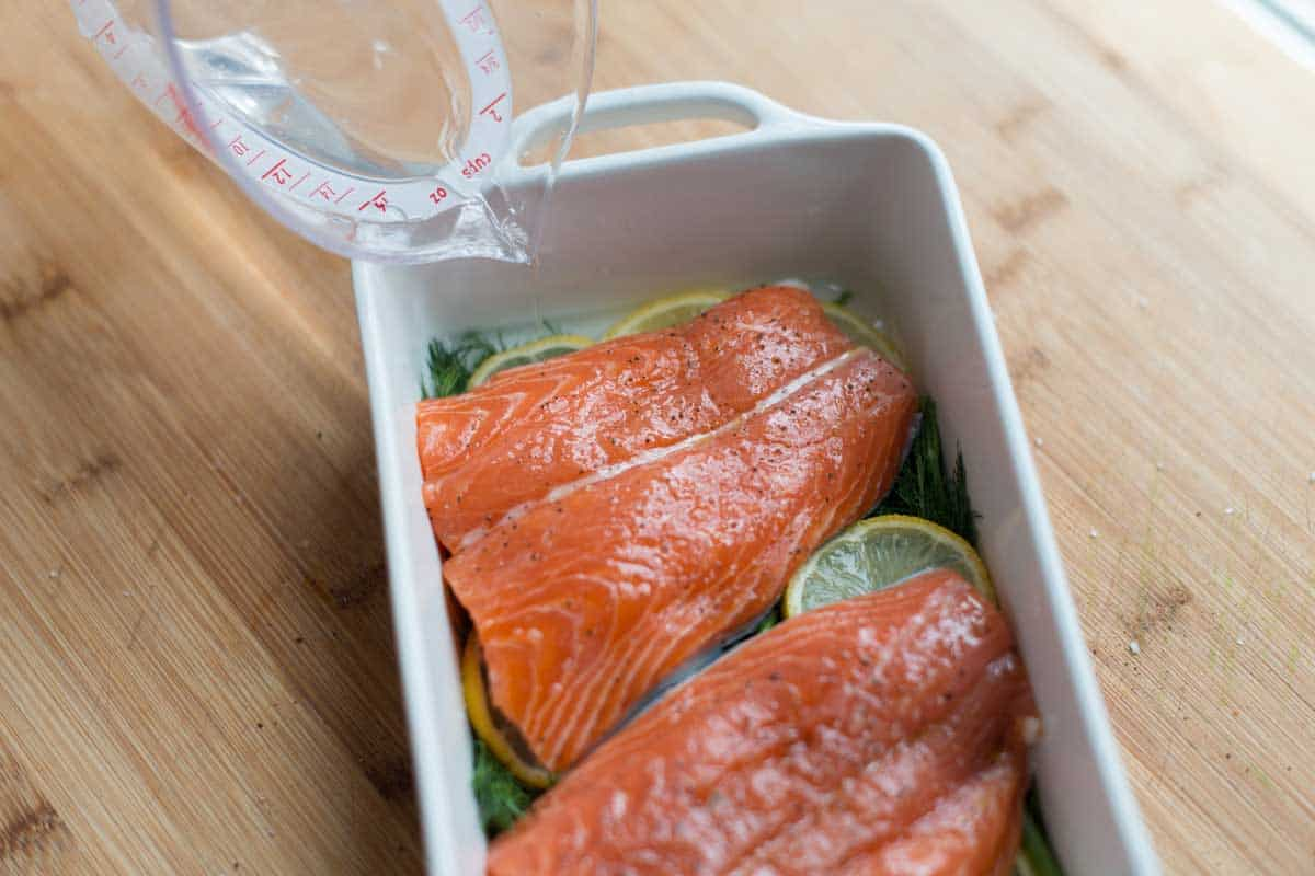 How to Cook Salmon -- For moist and tender salmon, add a little liquid like water, broth, or dry white wine.