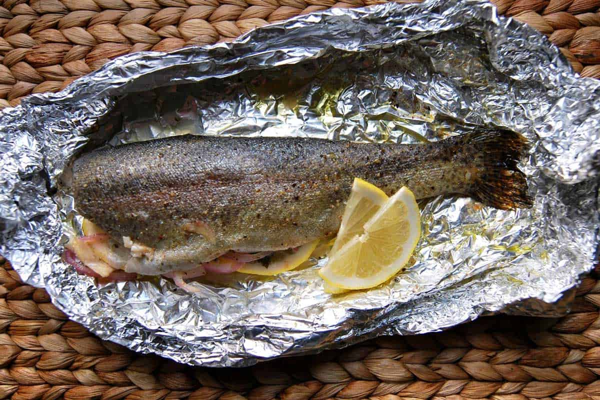 Perfectly baked fish recipe with scallions and orange for Fish in foil in oven
