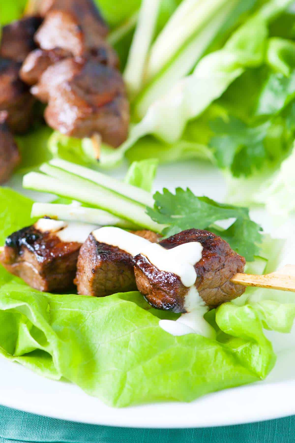 How to make honey Sriracha marinated beef skewers