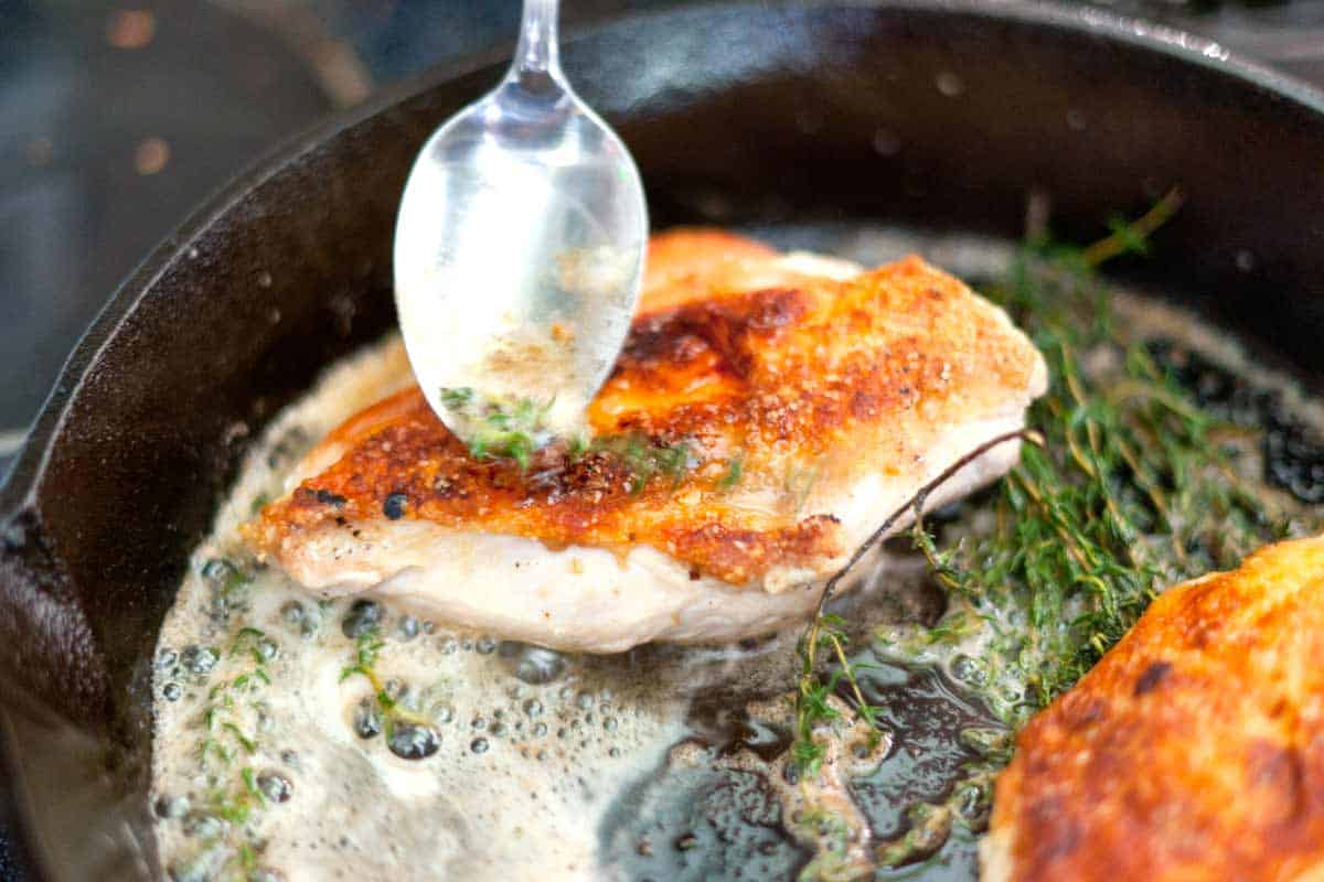 Spoon the thyme butter over the chicken