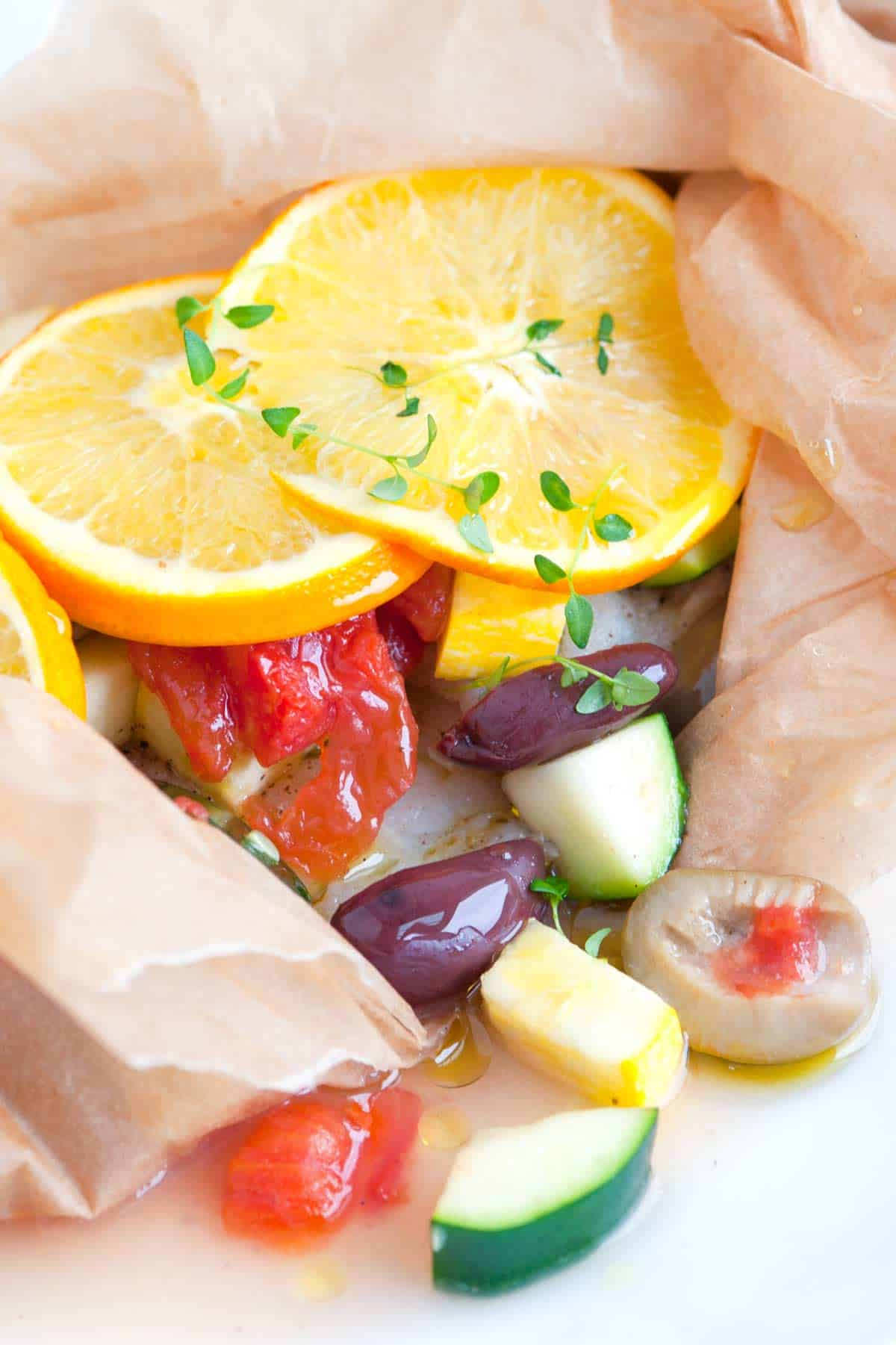 Easy baked fish in parchment with orange and olives for How to cook baked fish