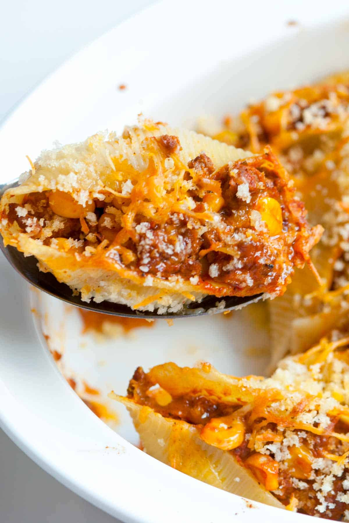 Taco inspired pasta shells filled with spiced ground beef, cheese and corn.