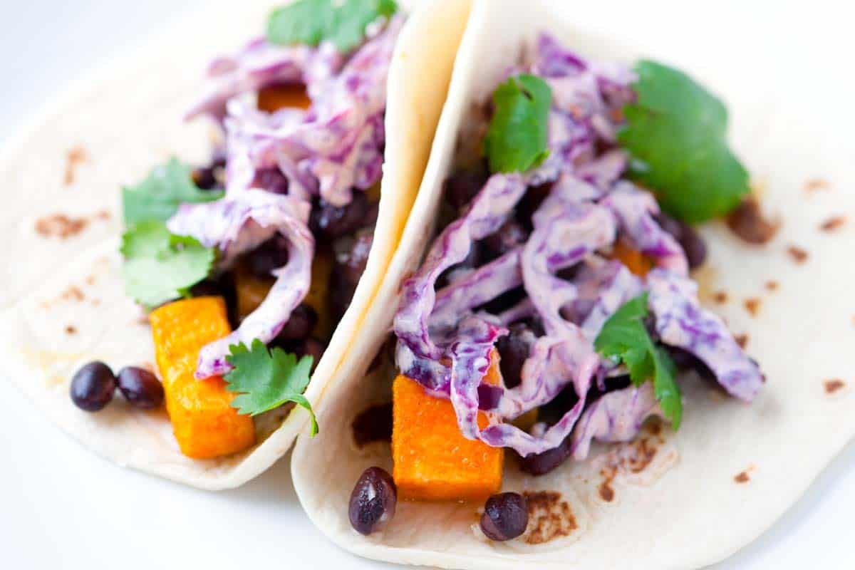 Roasted Sweet Potatoes and Black Bean Tacos with Chipotle Slaw