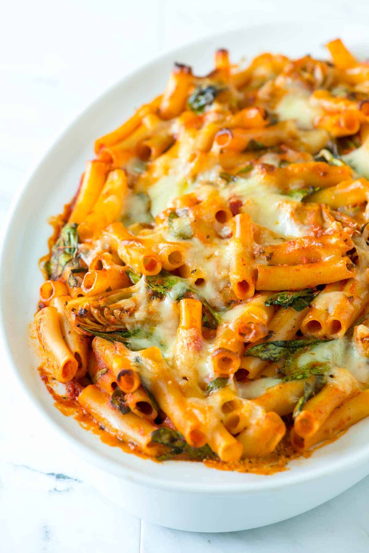 How to Make Seriously Good Baked Ziti with Spinach, Artichokes, and a Creamy Pesto Layer