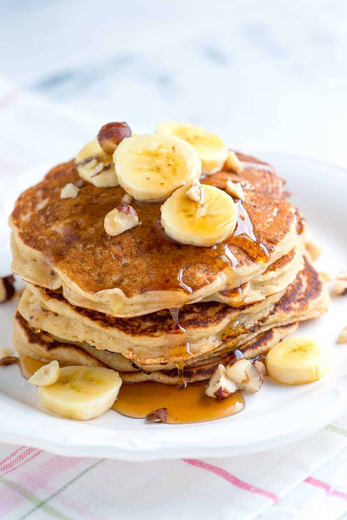 Our easy banana pancakes with buttermilk and warm spices takes less than 30 minutes and make even the pickiest eaters happy.