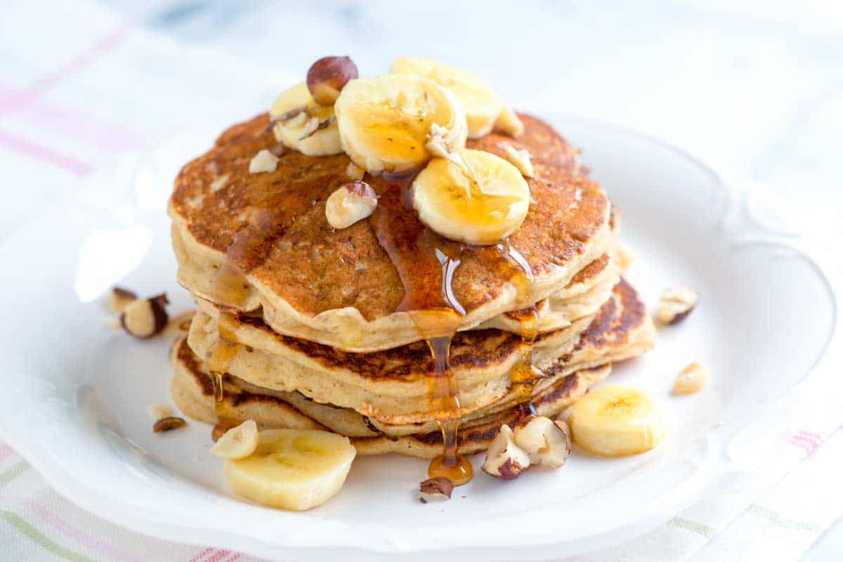 Our easy banana pancakes with buttermilk and warm spices takes less than 30 minutes and make even the pickiest eaters happy