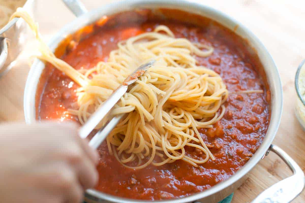 Toss spaghetti with marinara sauce