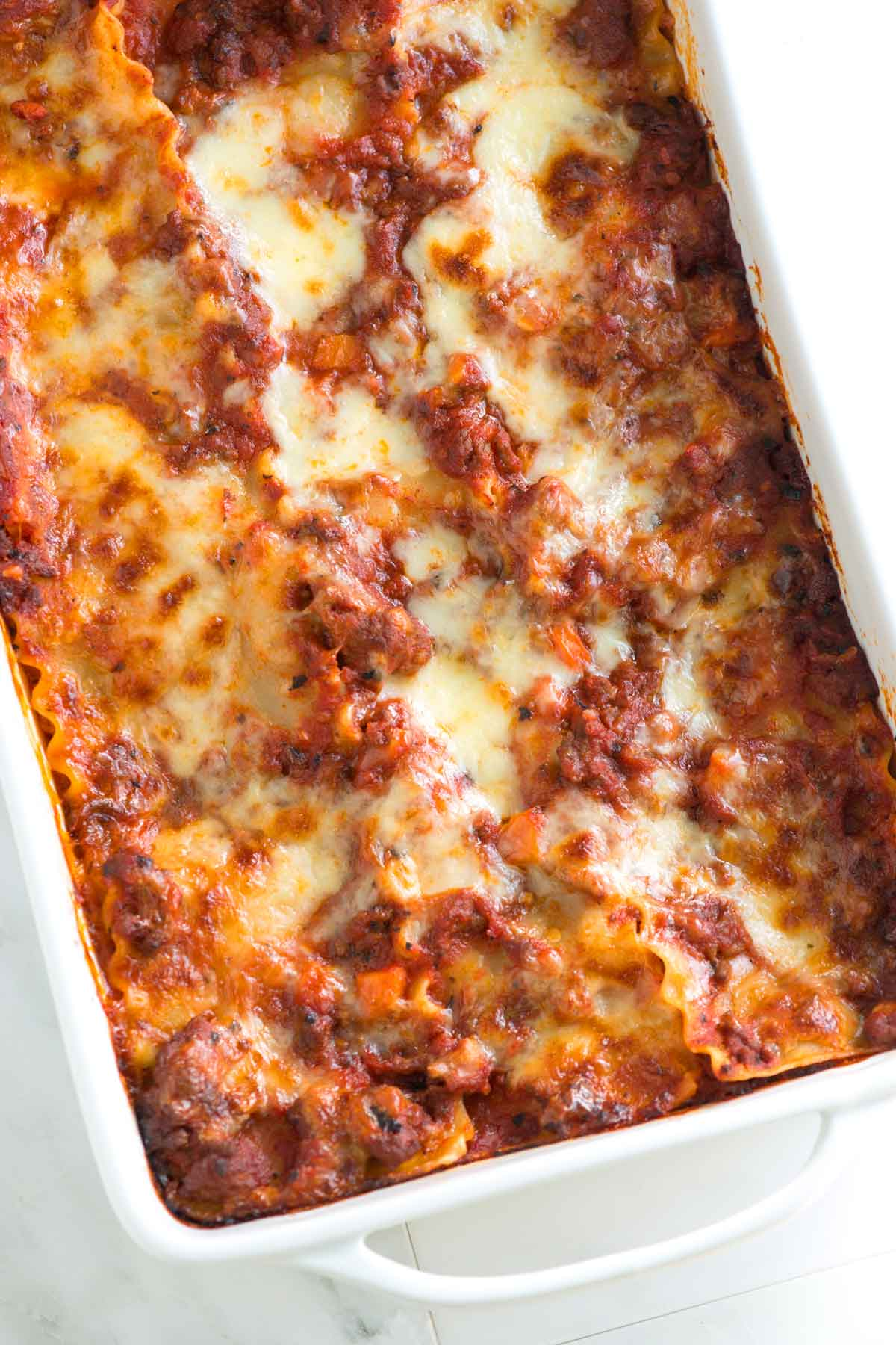A meaty and incredibly delicious lasagna recipe with Italian sausage, ground beef, and cheese. Plus, our tips for making it in advance.