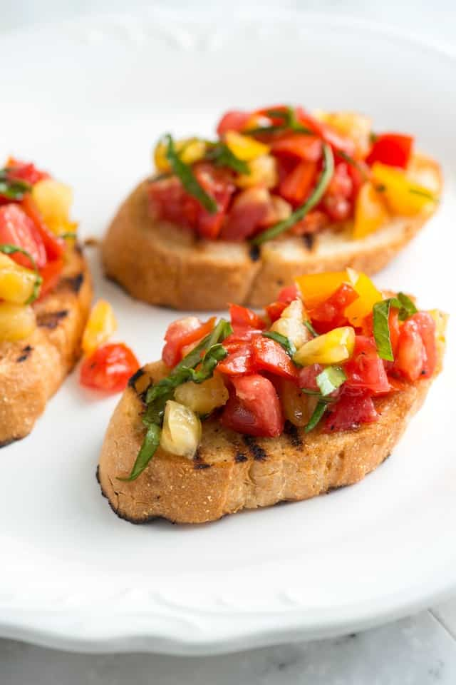 Simple bruschetta recipe from www.inspiredtaste.net -- With tomatoes ...