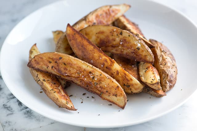 Oven fries recipe with olive oil, salt, pepper and rosemary.