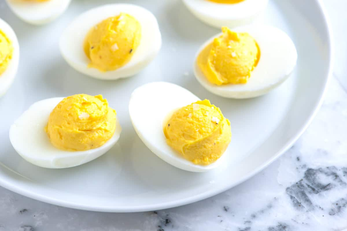 How to make the best deviled eggs with mayonnaise, vinegar, and mustard. Plus, suggestions for spicing them up and our best tips for hard boiling eggs.