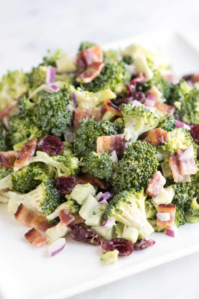 Easy broccoli salad recipe with bacon, cranberries, red onion and a ...
