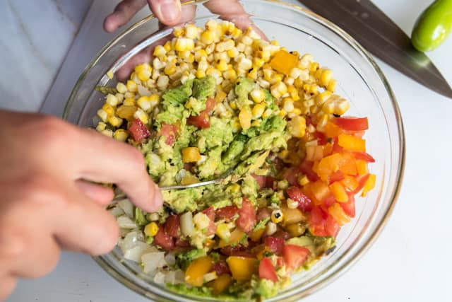 Easy Guacamole Recipe starring blistered avocados, corn and jalapeños