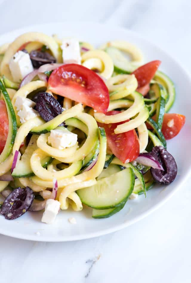 guilt-free zucchini noodles salad with cucumber, tomatoes, feta and ...