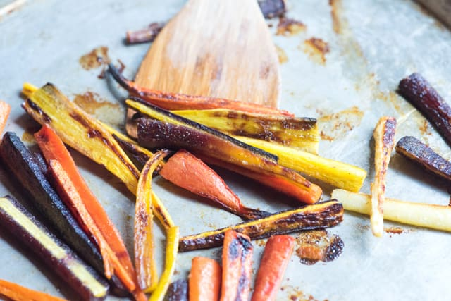 Carrots are roasted until browned and tender -- in a 400 degree oven, that takes just about 20 minutes.