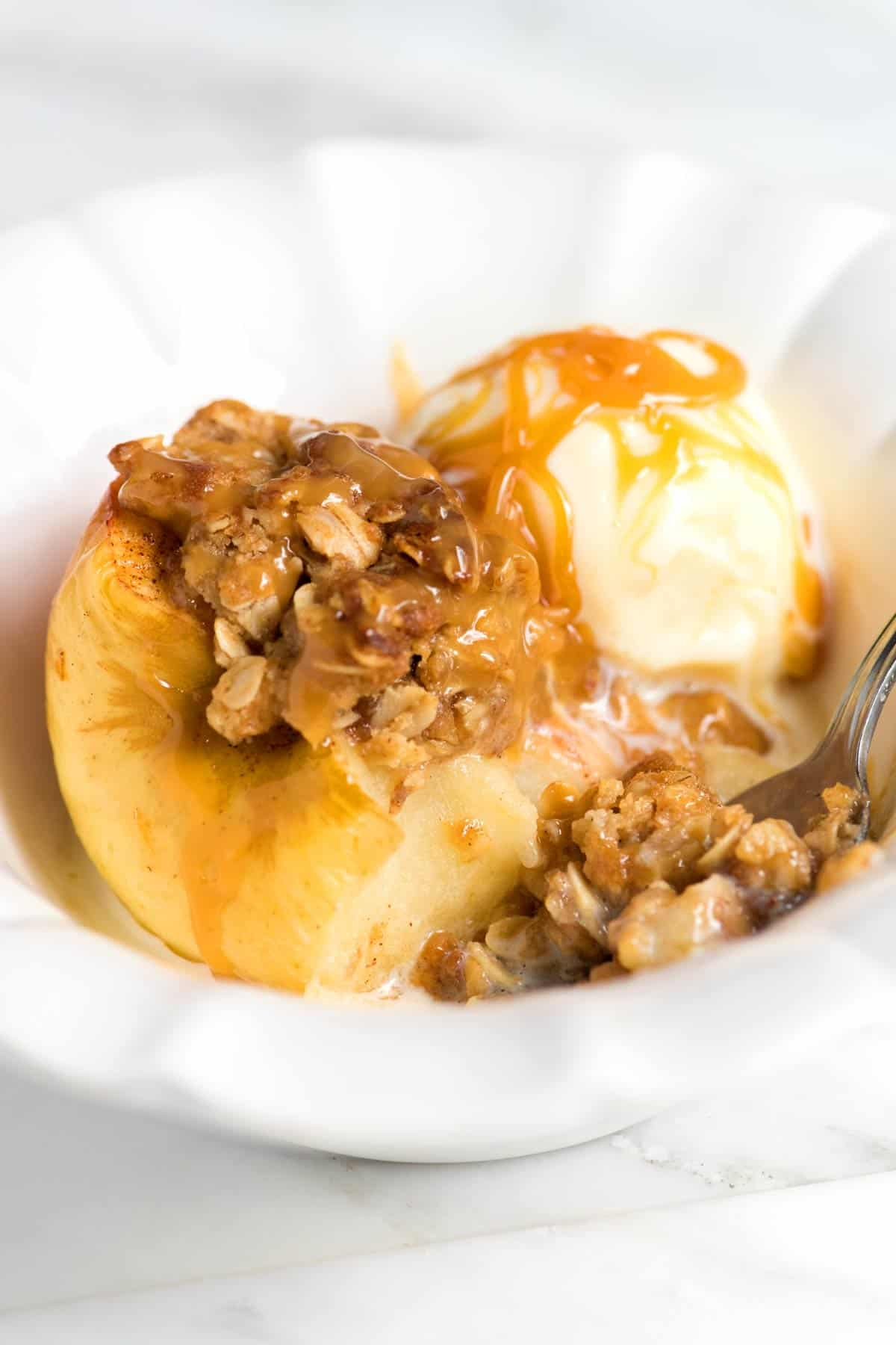 Serve cinnamon baked apples with ice cream and caramel sauce!