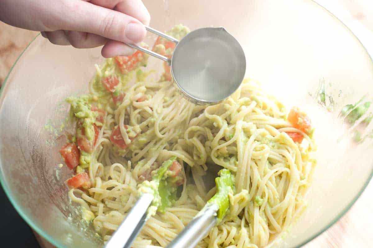 Tossing the avocado sauce and pasta
