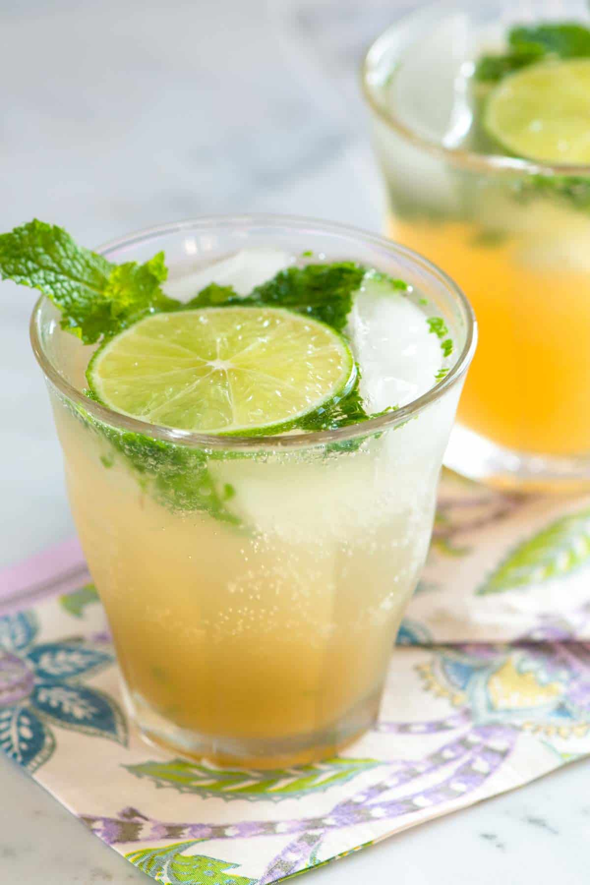 Our favorite mojito recipe with white rum, fresh lime, and mint. I'll share how to make mojitos for one as well as how to make them in a pitcher, perfect for serving a crowd.