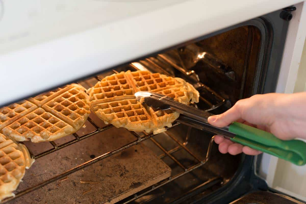 As waffles sit, they loose their crispness. To prevent floppy waffles, keep the cooked waffles in a warm oven while you finish cooking the rest of the batch.