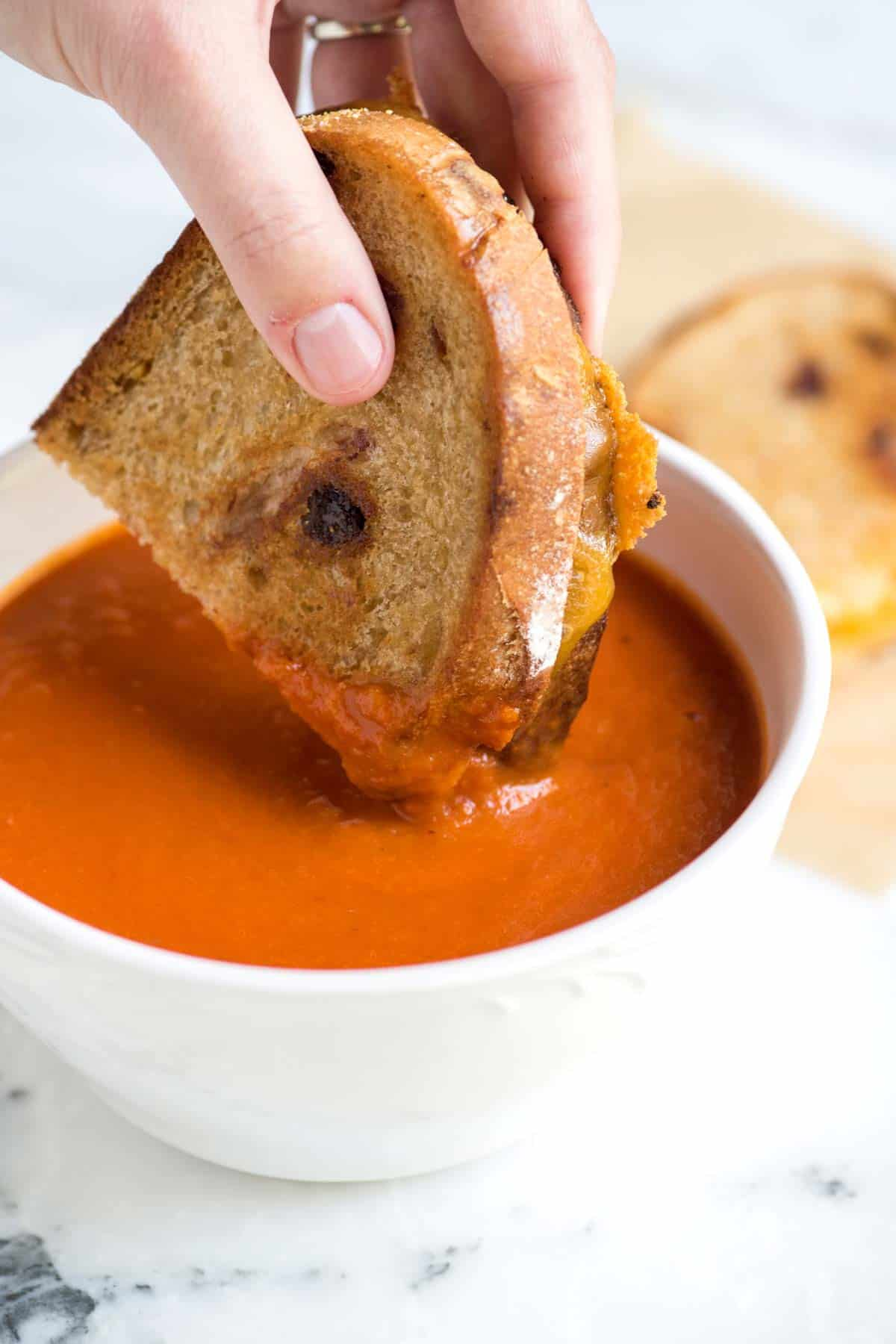 Easy Three-Ingredient Tomato Soup Recipe // My favorite tomato soup recipe! You wouldn't think that three ingredients — butter, onion, and tomato — can come together to make such a velvety and delicious tomato soup, but let me tell you. They can.