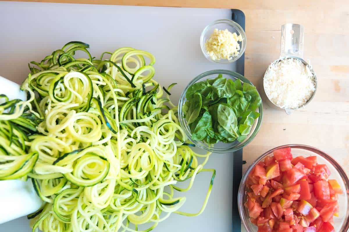 This zucchini pasta recipe is all about fresh ingredients. The zucchini should be firm and the tomatoes sweet.