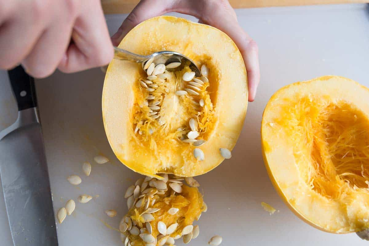 Scooping out the seeds of spaghetti squash