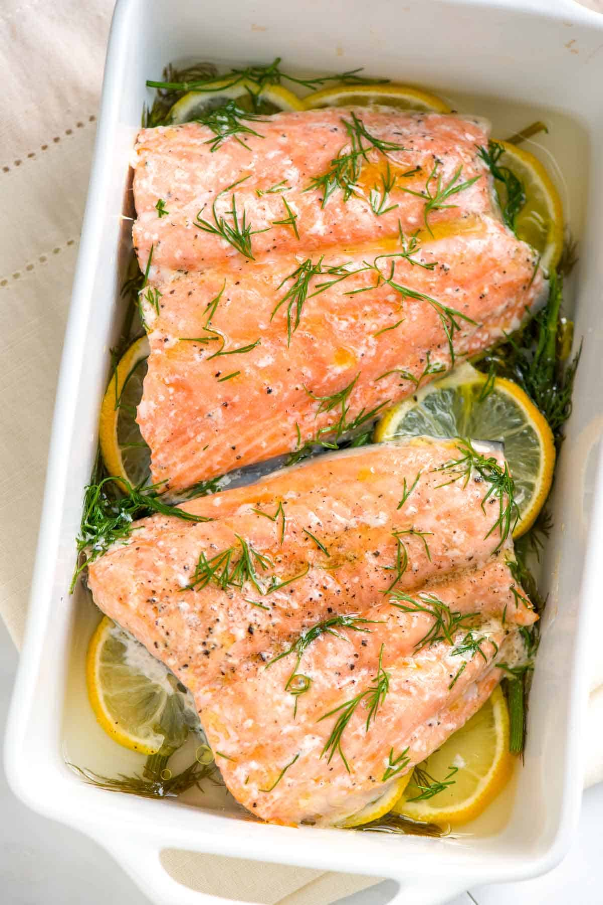 The trick to perfectly cooked salmon is to gently bake the fish in a little liquid. You could call it oven poached salmon.