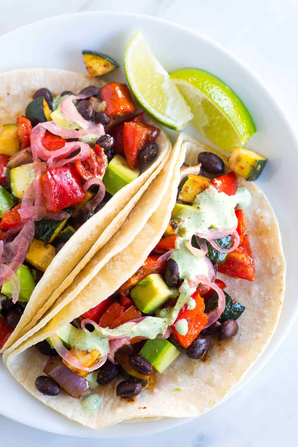 These vegetable tacos could not be easier and are perfect for quick mid-week meals. Both the vegetables and sauce can be made days in advance.