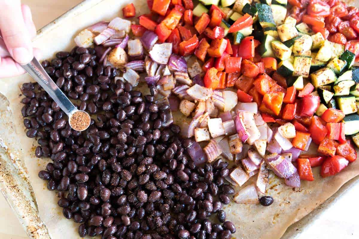 About 5 minutes before the vegetables are done, we add cooked (or canned) black beans.