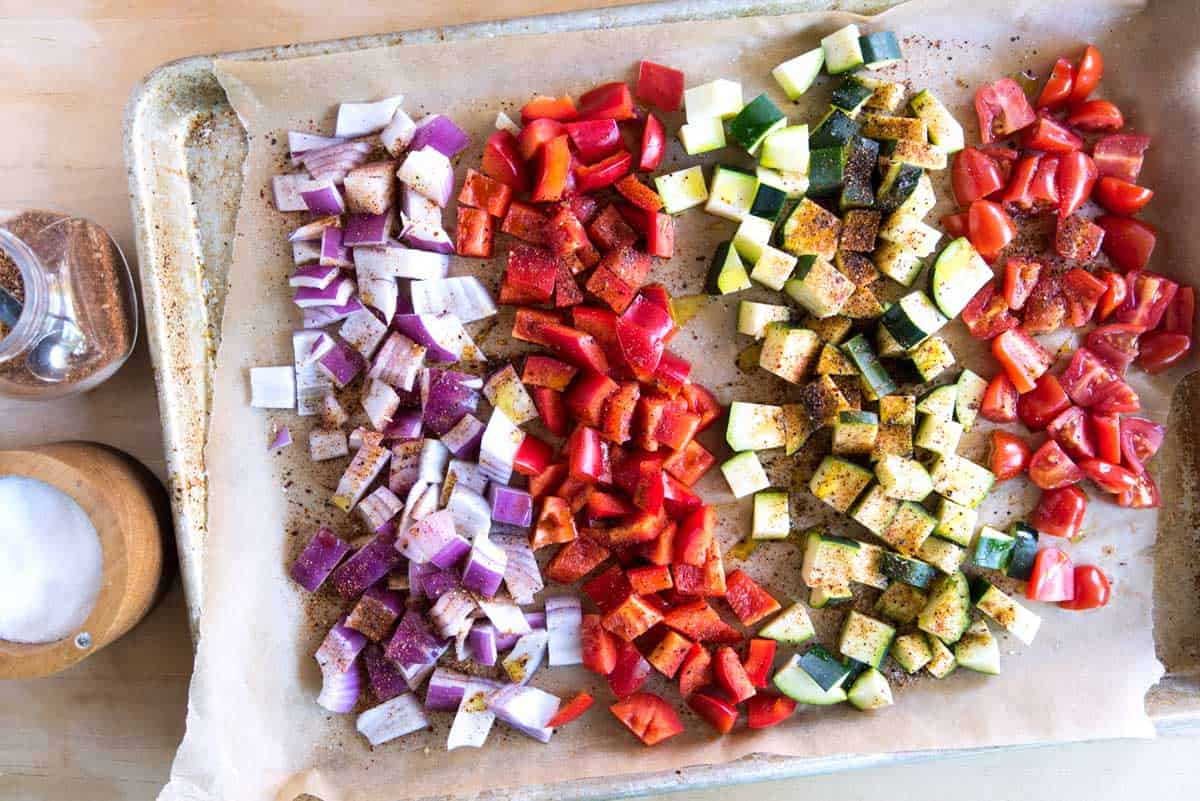 Roasting the veggies makes their flavor intensify. Remember to cut everything into a similar size so they roast evenly.