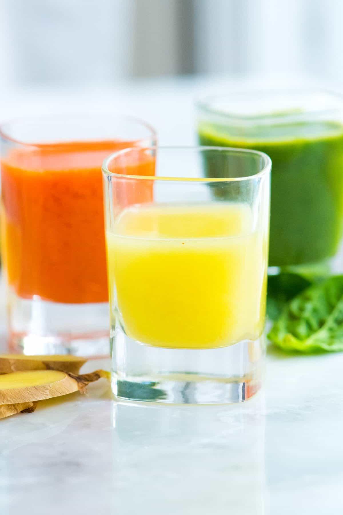 Three Ginger Power Shot Recipes including Lemon Ginger, Carrot Ginger and a Green Apple Ginger Shot