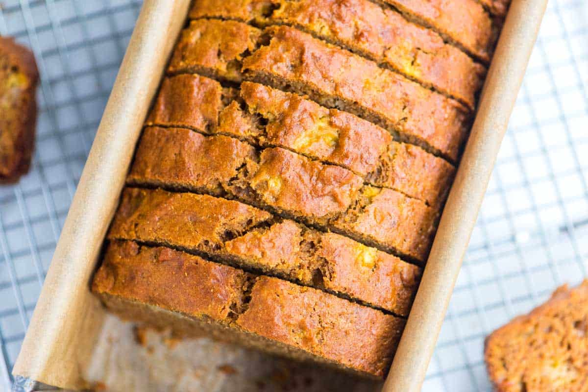 How to make healthy banana bread that actually tastes good! This recipe has lower sugar, healthier fats and adds whole grains.