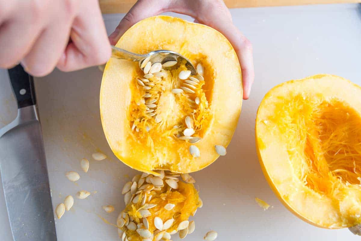 How to Cook Spaghetti Squash in the Oven or Microwave -- Scooping Out the Seeds