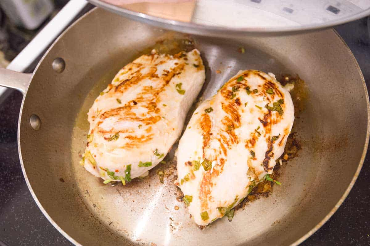 Cook the chicken in a skillet with a lid