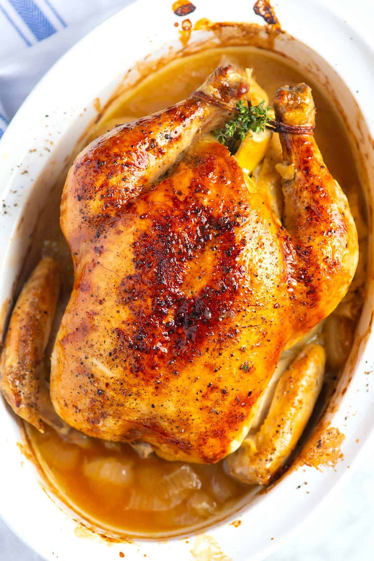 How to easily roast a whole chicken with lemon and garlic. The meat stays juicy and the chicken becomes ultra-flavorful.