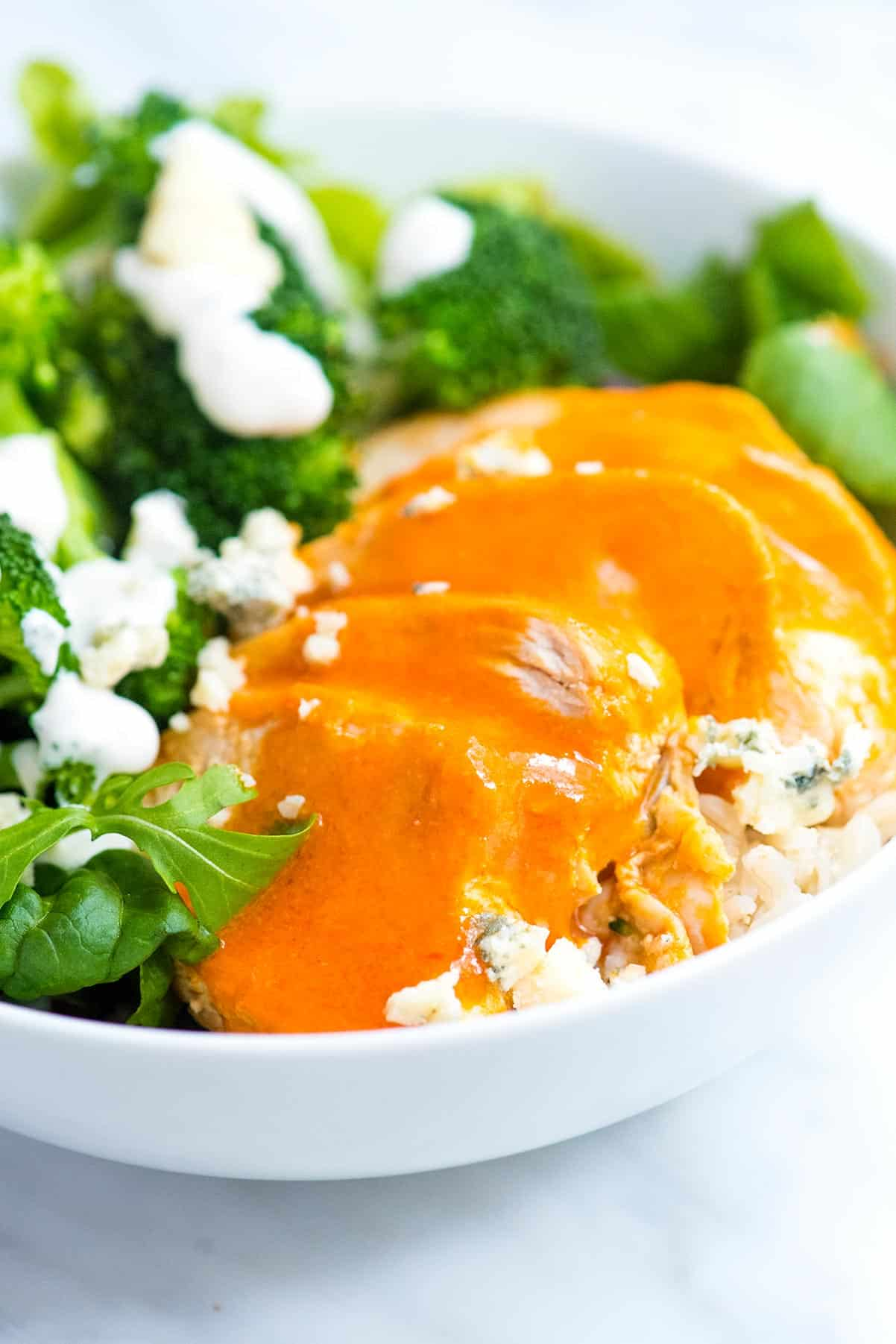 These satisfying buffalo chicken rice bowls are easy to make, packed with good for you ingredients and taste great.