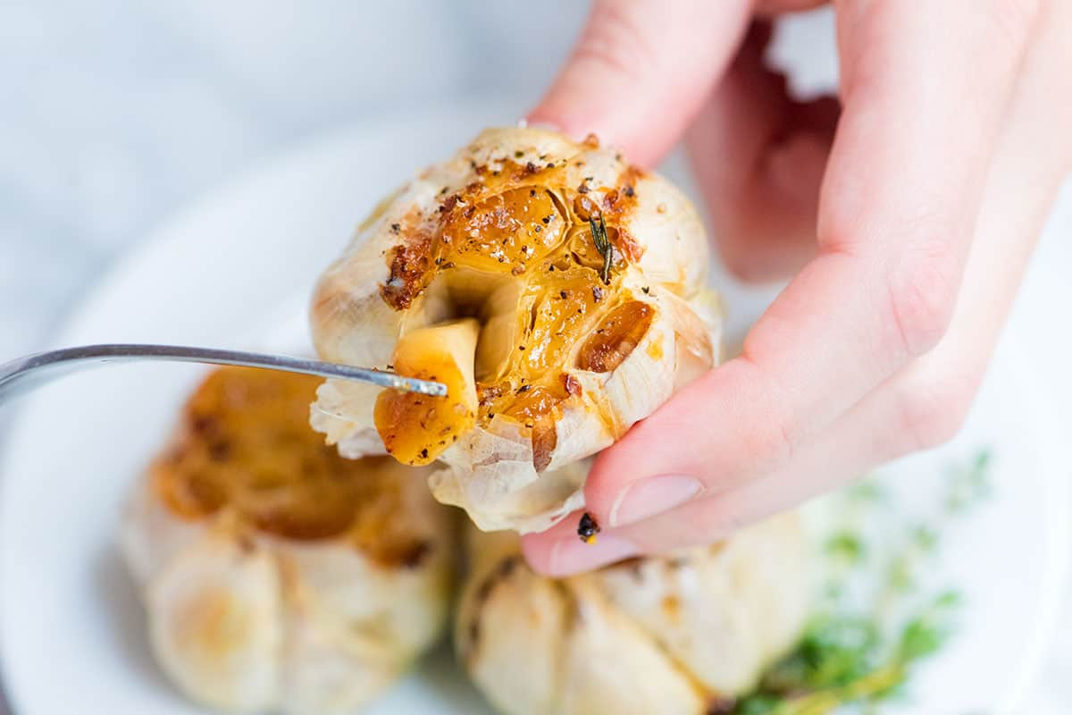 Roasted garlic is one of the best things you can make in your oven. We're sharing how to roast garlic and lots of ways to use it.