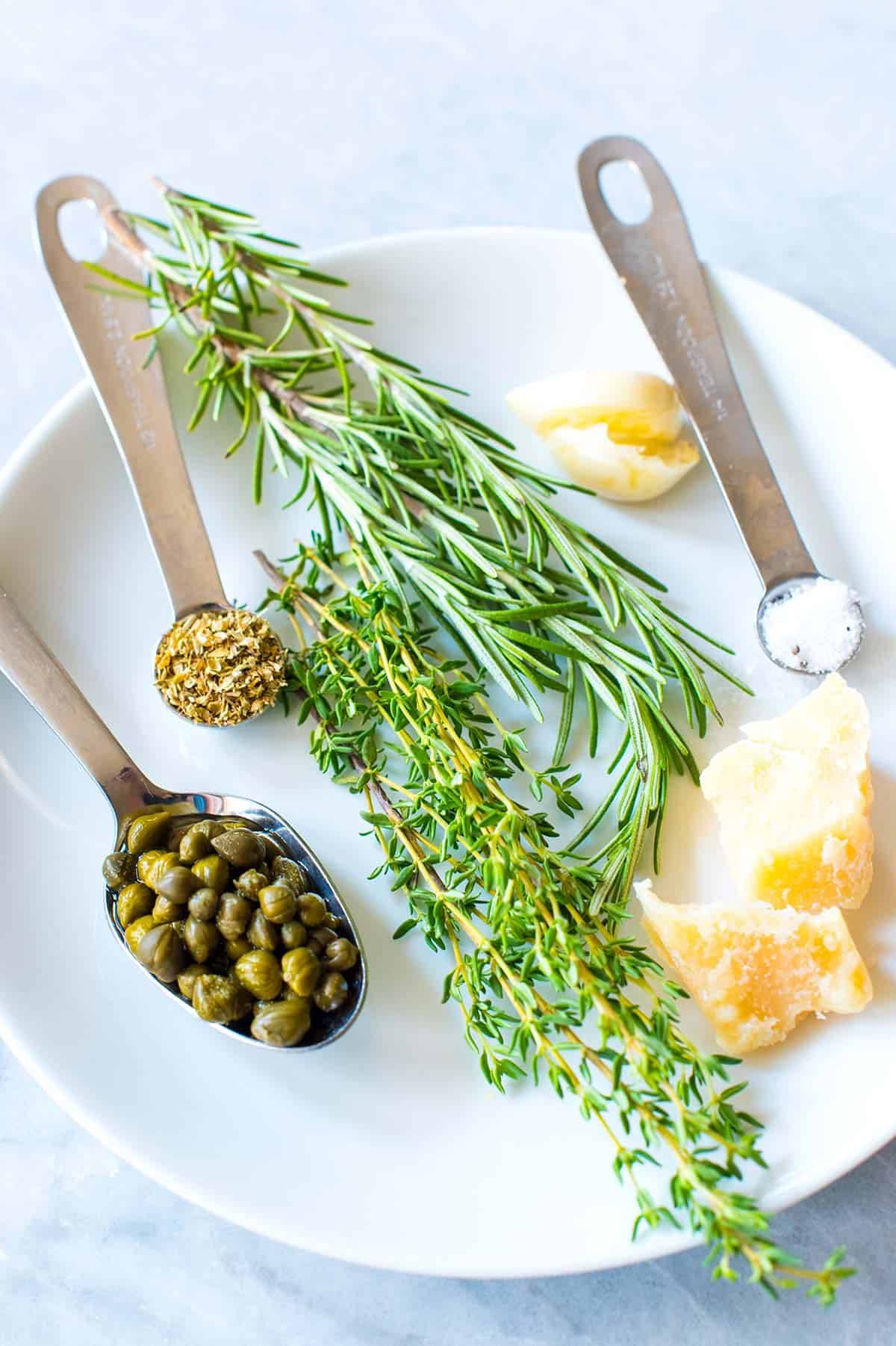 This easy and group-friendly olive oil dip comes together really quickly and it never fails. I mean, who doesn't want to dip bread into an herby, garlicky, parmesan cheese infused olive oil?