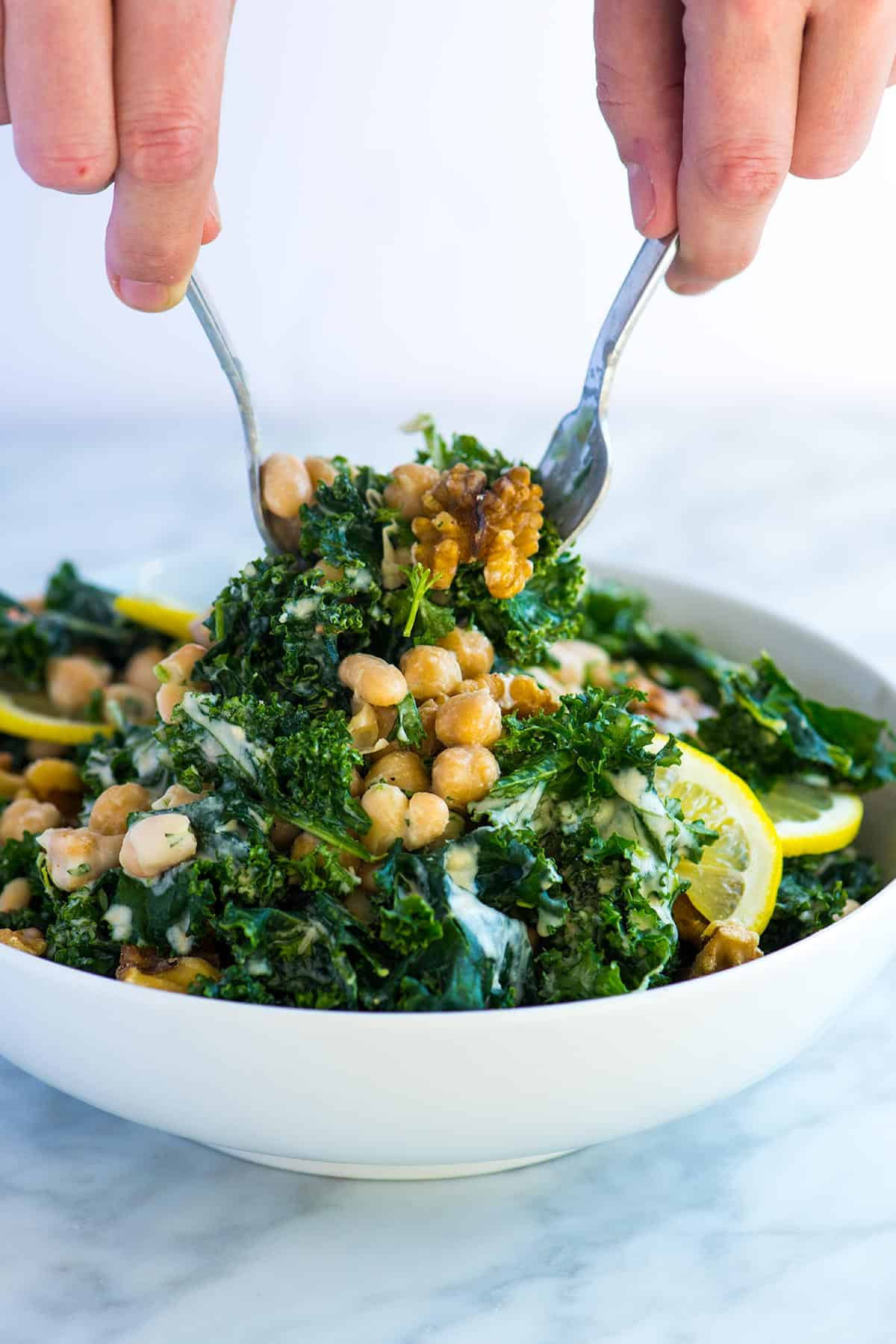 This easy kale and bean salad is packed with good for you ingredients, is practically crave-worthy and can be made in advance.