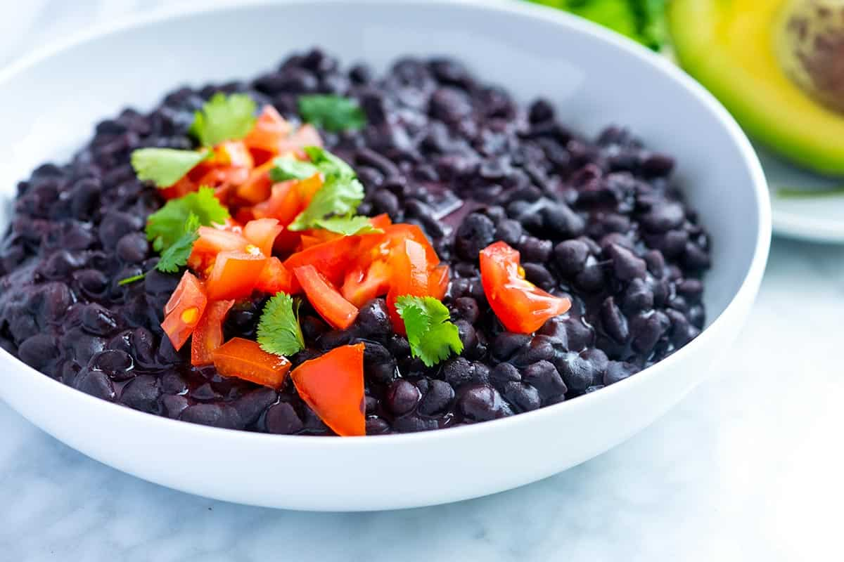 Easy creamy coconut black beans recipe made completely from scratch. See how to make the creamiest black beans ready for any meal. You only need one pot!