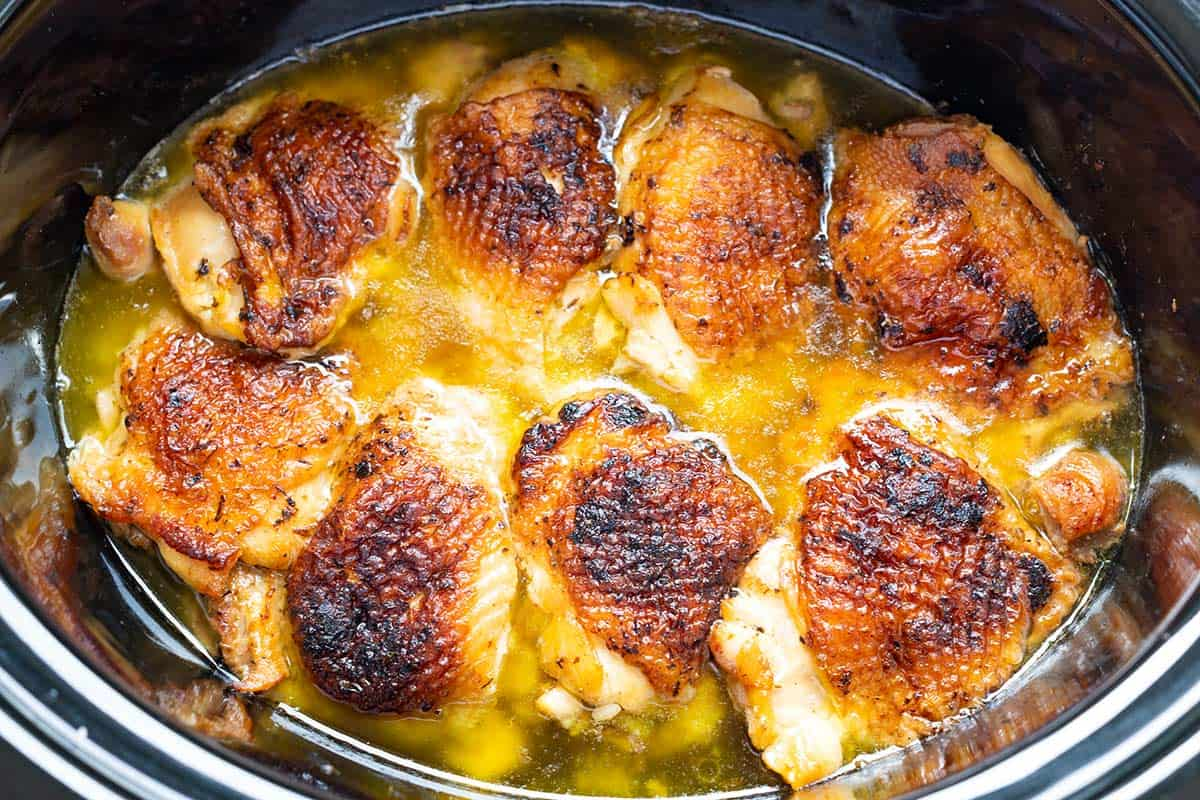 Easy slow cooker chicken recipe! See how we make ultra tender lemon chicken in our slow cooker with a lemony chicken gravy. So delicious!