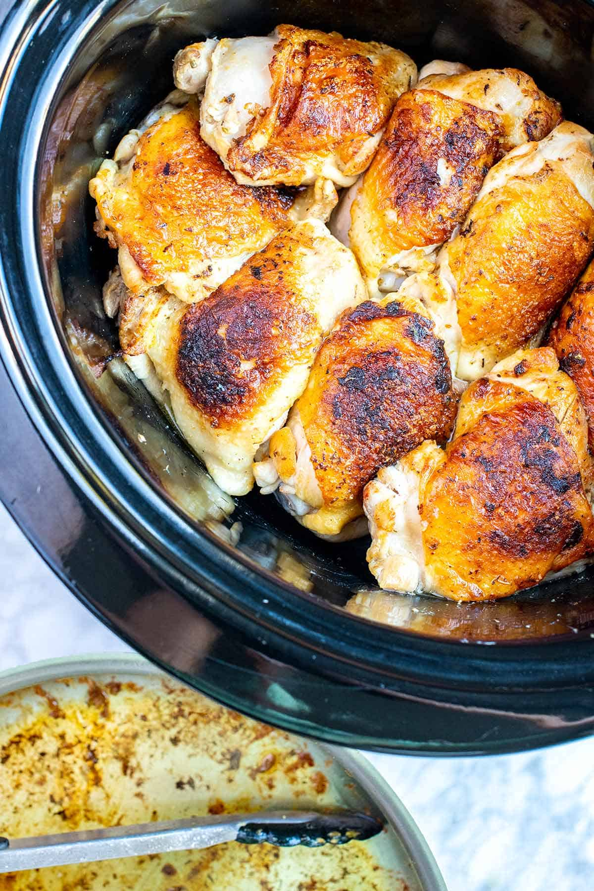 For the best slow cooker chicken thighs, brown the skin in a skillet first, and then add to the slow cooker. No additional liquid is required.