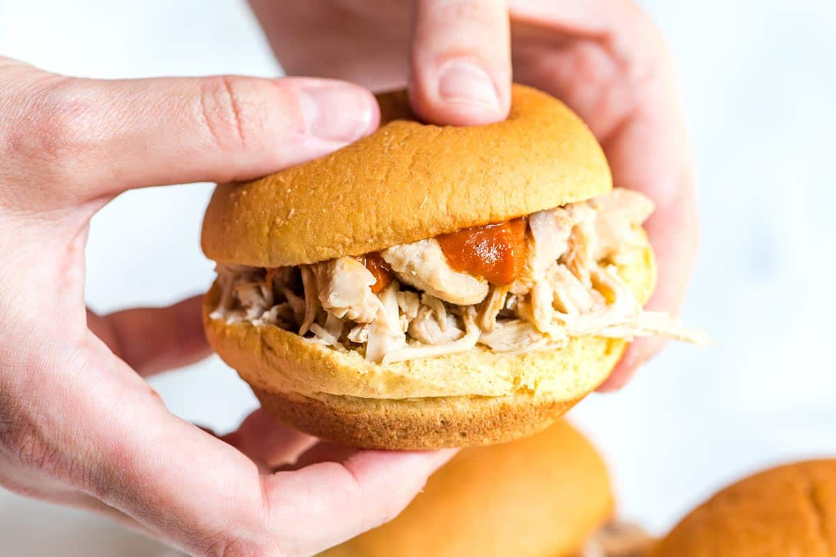 How to make tender and flavorful shredded chicken using a slow cooker. Try this easy recipe and use for sandwiches, tacos and more.