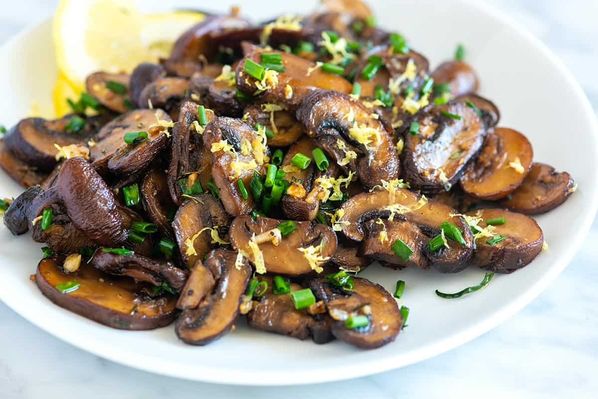 How to make deeply flavored oven roasted mushrooms with perfect brown edges. Use any type or size of mushroom!