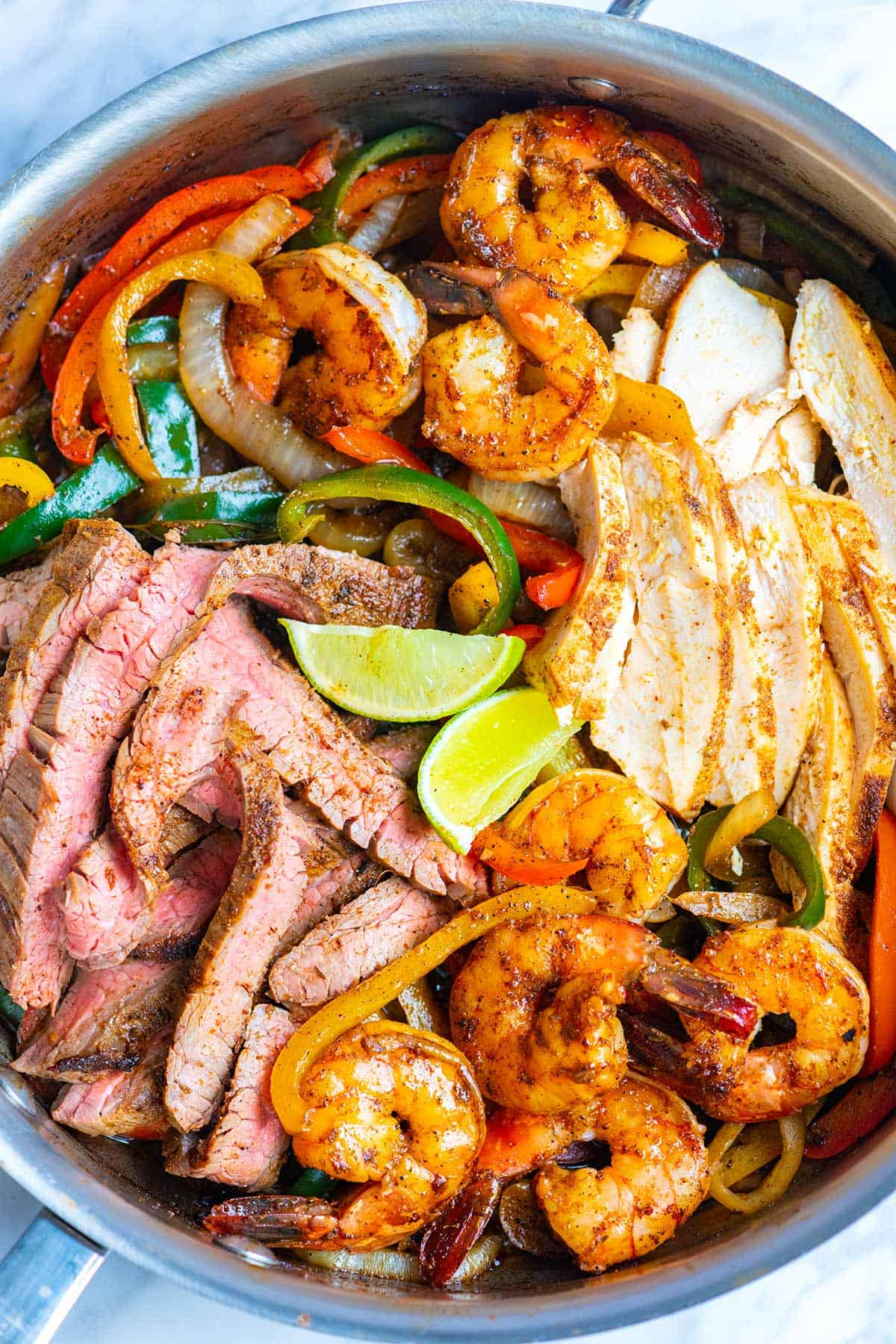 Steak, Chicken, and Shrimp fajitas cooked and ready to serve.