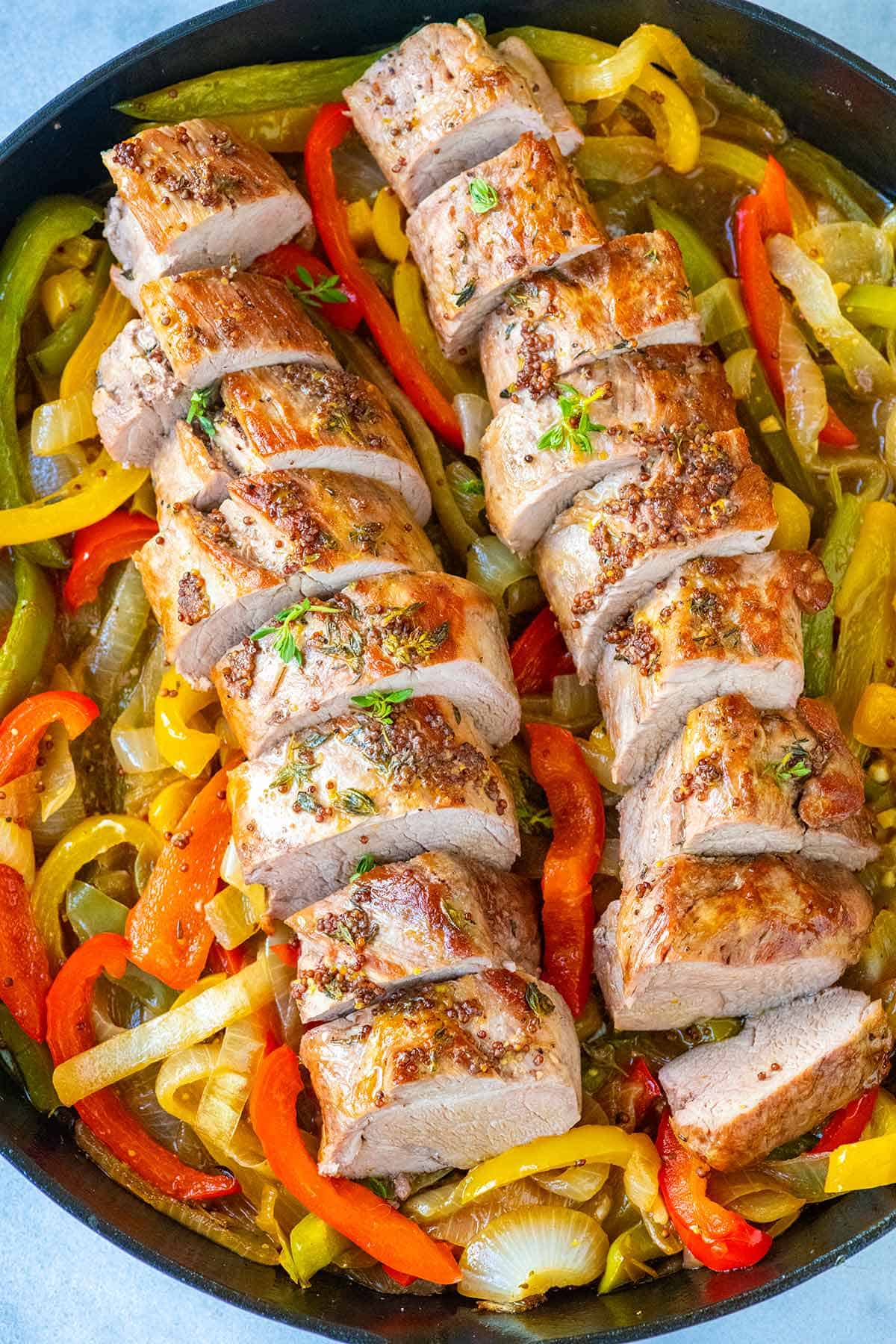 Sliced Pork Tenderloin with Peppers and Onions