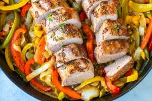 Juicy Pork Tenderloin Recipe with Peppers and Onions