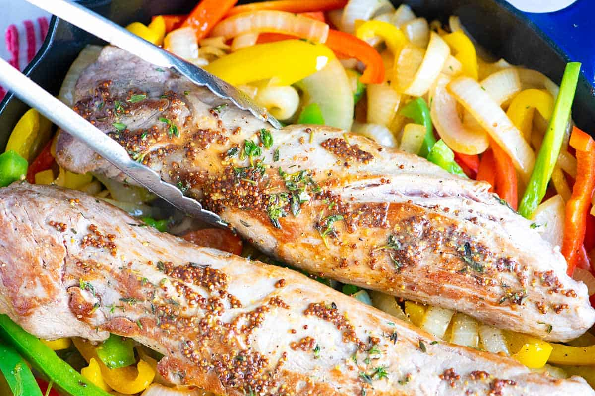 How to Make Juicy Pork Tenderloin with Peppers and Onions