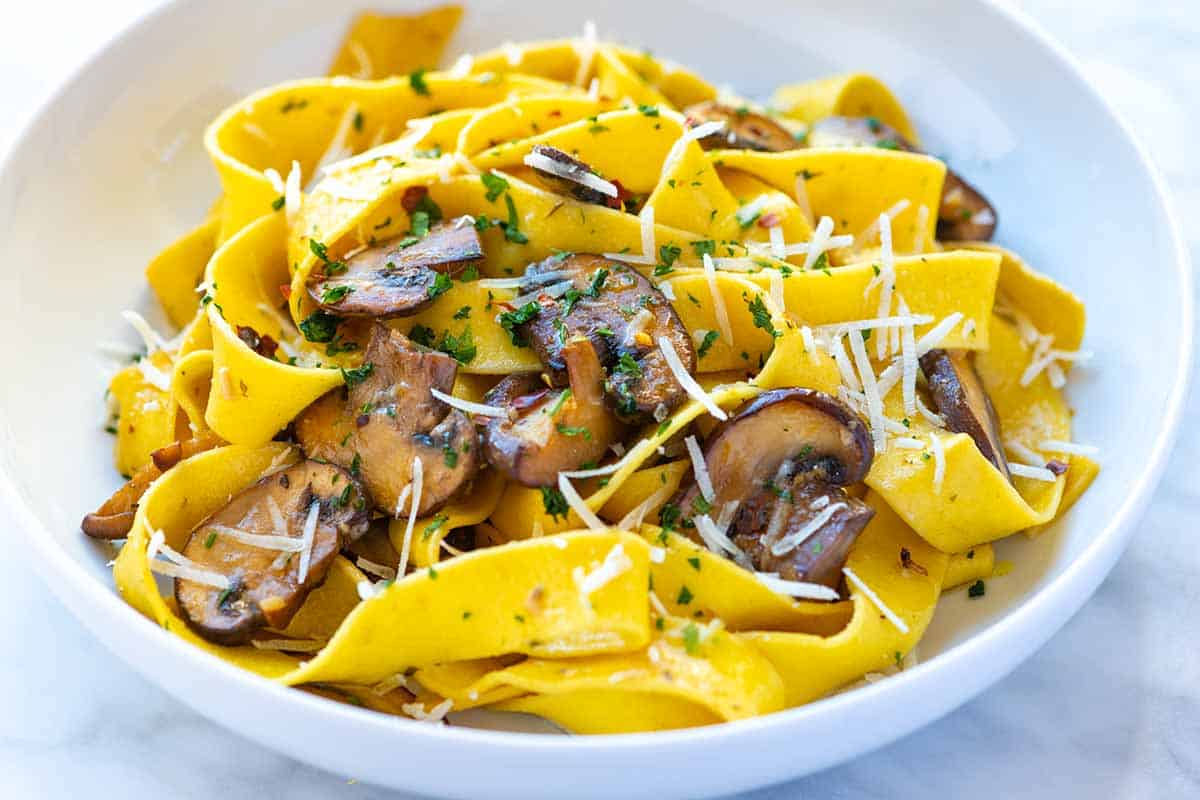 Mushroom pasta recipe with the most delicious garlic butter mushrooms. Thanks to our no-fail method for cooking mushrooms, this easy pasta comes together in under 30 minutes and tastes amazing!
