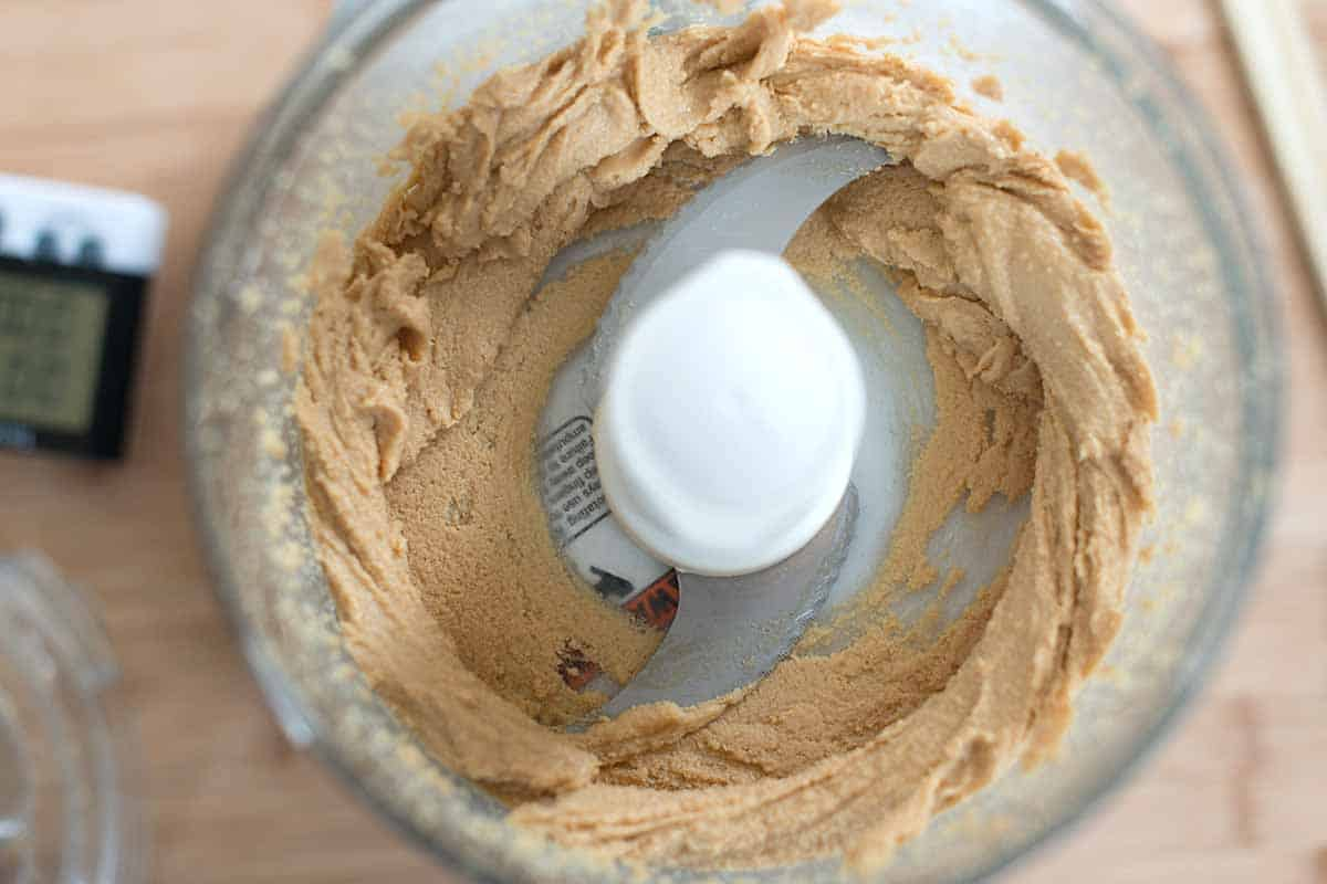 After a minute of processing, the peanut butter looks more like a thick paste.